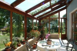 také u zimních zahrad je třeba počítat s moderními okenními systémy