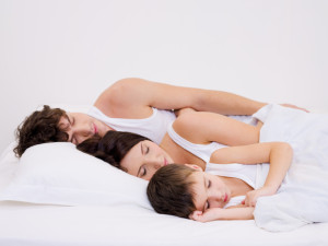 Young beautiful Sleeping family with the little son